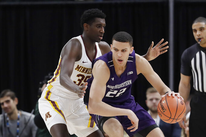 Northwestern's Pete Nance (22) works the ball against Minnesota's Isaiah Ihnen (35) during the first half of an NCAA college basketball game at the Big Ten Conference tournament, Wednesday, March 11, 2020, in Indianapolis. (AP Photo/Darron Cummings)