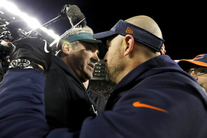 Philadelphia Eagles head coach Doug Pederson, left, and Chicago Bears head coach Matt Nagy greet each other after an NFL wild-card playoff football game Sunday, Jan. 6, 2019, in Chicago. The Eagles won 16-15. (AP Photo/Nam Y. Huh)