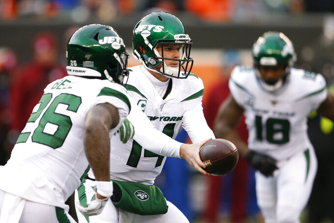FILE - In this Dec. 1, 2019, file photo, New York Jets quarterback Sam Darnold (14) looks to hand off the ball to running back Le'Veon Bell (26) during the first half of an NFL football game against the Cincinnati Bengals in Cincinnati. When the Jets traded up in the draft to select him with the No. 3 overall pick in 2018, they envisioned Darnold as the franchise quarterback they have been searching for since, well, the glory days of Joe Namath. (AP Photo/Gary Landers, File)