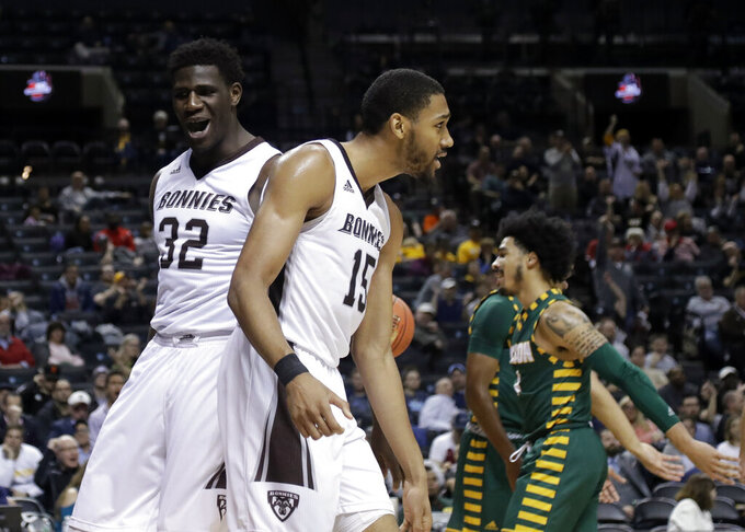 St. Bonaventure's LaDarien Griffin (15) celebrates with teammate Amadi Ikpeze (32) during the first half of an NCAA college basketball game against the George Mason in the Atlantic 10 conference tournament Friday, March 15, 2019, in New York. (AP Photo/Frank Franklin II)