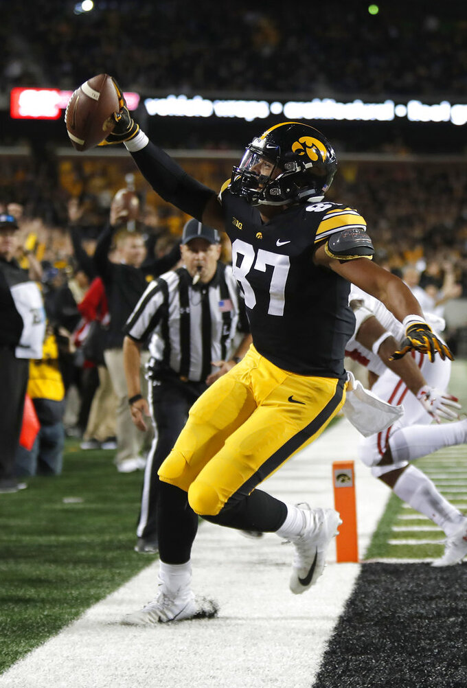 FILE - In this Sept. 22, 2018, file photo, Iowa tight end Noah Fant gestures after scoring during the second half of an NCAA college football game against Wisconsin, in Iowa City. Fant says he's leaving school early to enter the NFL draft. Fant announced on his Instagram page on Friday, Nov. 30, 2018, that he intends to forego his final season of eligibility to turn pro. (AP Photo/Matthew Putney, File)