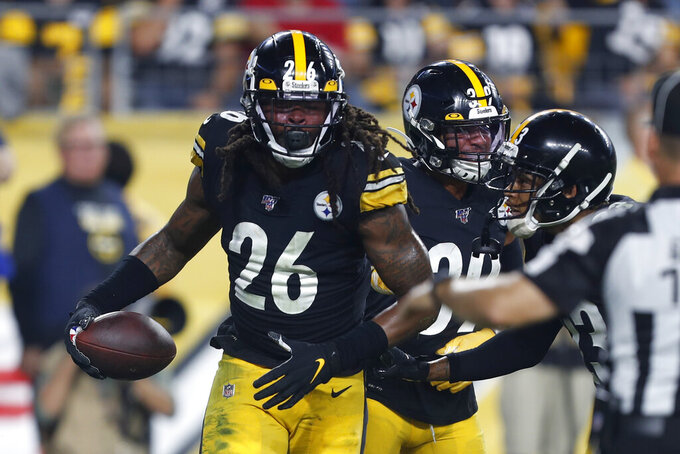 Pittsburgh Steelers inside linebacker Mark Barron (26) celebrates his interception in the end zone of a pass by Cincinnati Bengals quarterback Andy Dalton during the second half of an NFL football game in Pittsburgh, Monday, Sept. 30, 2019. (AP Photo/Tom Puskar)