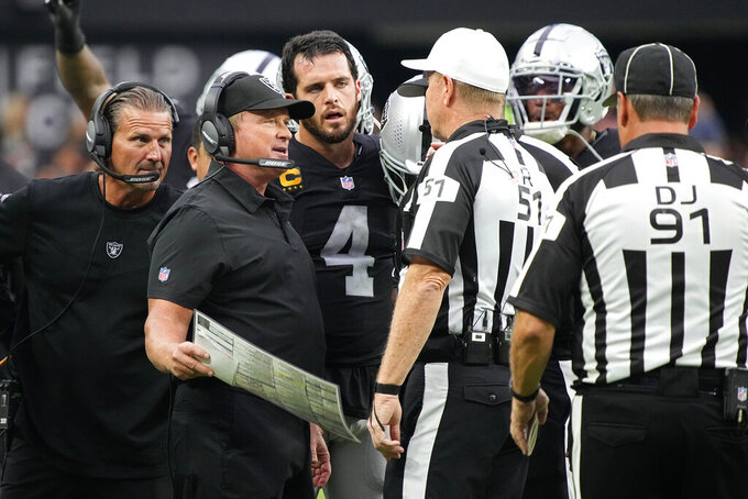 Las Vegas Raiders head coach Jon Gruden speaks with officials during the second half of an NFL football game against the Miami Dolphins, Sunday, Sept. 26, 2021, in Las Vegas. (AP Photo/Rick Scuteri)