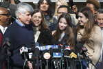 Former Illinois Gov. Rod Blagojevich, left, is joined by his wife, Patti, daughters Annie and Amy at a news conference outside his home Wednesday, Feb. 19, 2020, in Chicago. On Tuesday, President Donald Trump commuted Blagojevich's 14-year prison sentence for political corruption. (AP Photo/Charles Rex Arbogast)