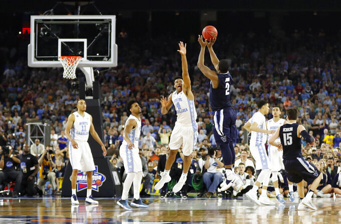 FILE - In this April 4, 2016, file photo, Villanova's Kris Jenkins makes the game-winning three-point shot during the second half of the NCAA Final Four tournament college basketball championship game against North Carolina, in Houston. (AP Photo/David J. Phillip)