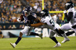 Tennessee Titans' Jeremy McNichols, left, is tackled by Philadelphia Eagles' L.J. Fort during the first half of a preseason NFL football game Thursday, Aug. 8, 2019, in Philadelphia. (AP Photo/Michael Perez)