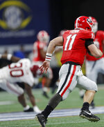 Georgia quarterback Jake Fromm (11) runs against Alabama during the second half of the Southeastern Conference championship NCAA college football game, Saturday, Dec. 1, 2018, in Atlanta. (AP Photo/John Bazemore)