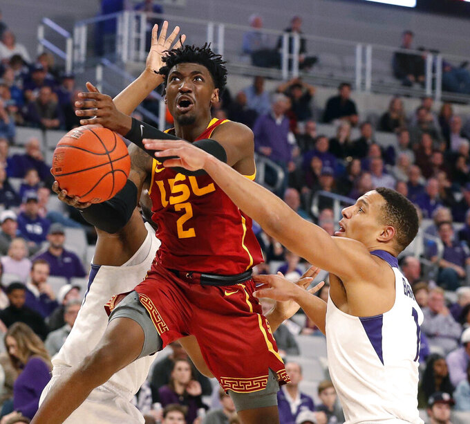 Southern California guard Jonah Mathews (2) attempts a shot while defended by TCU guard Desmond Bane, right, during the second half of an NCAA college basketball game in Fort Worth, Texas, Friday, Dec. 6, 2019. (Bob Booth/Star-Telegram via AP)