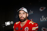 In this Wednesday, Jan. 29, 2020 photo, Kansas City Chiefs offensive guard Laurent Duvernay-Tardif (76) speaks during a news conference in Aventura, Fla., for the NFL Super Bowl 54 football game. (AP Photo/Brynn Anderson)