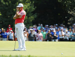Gary Woodland reacts after missing a putt on the fifth green during the second round of the PGA Championship golf tournament at Bellerive Country Club, Friday, Aug. 10, 2018, in St. Louis. (AP Photo/Jeff Roberson)