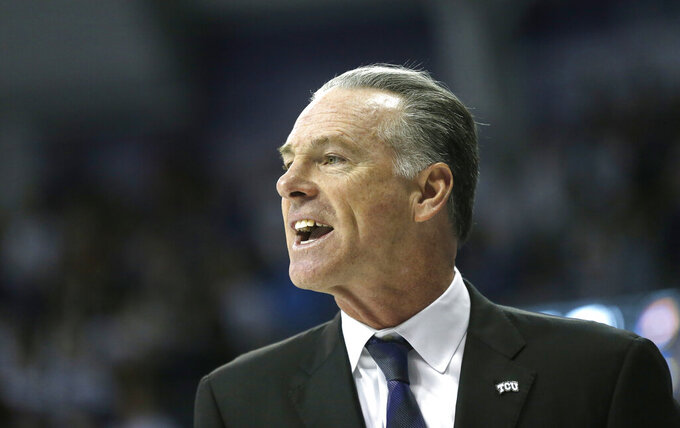 TCU head coach Jamie Dixon looks on from the sideline during the first half of an NCAA college basketball game against Kansas, Saturday, Feb. 8, 2020 in Fort Worth, Texas. Kansas won 60-46. (AP Photo/Ron Jenkins)