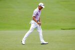 Justin Thomas reacts to his putt on the 13th hole during the final round of the Workday Charity Open golf tournament, Sunday, July 12, 2020, in Dublin, Ohio. (AP Photo/Darron Cummings)