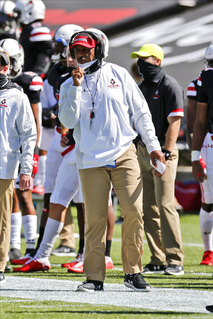 Austin Peay head coach Marquase Lovings instructs his team against Cincinnati during the first half of an NCAA college football game Saturday, Sept. 19, 2020, in Cincinnati, Ohio. Cincinnati beat Austin Peay 55-20. (AP Photo/Jay LaPrete)