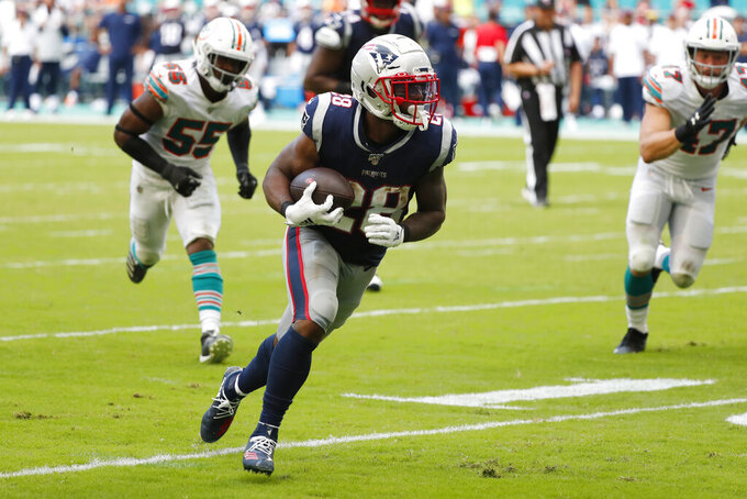 New England Patriots running back James White (28) runs for a touchdown, during the second half at an NFL football game against the Miami Dolphins, Sunday, Sept. 15, 2019, in Miami Gardens, Fla. (AP Photo/Wilfredo Lee)