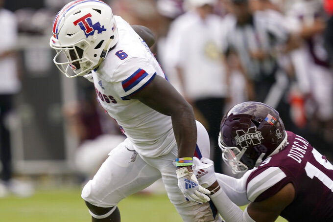 Louisiana Tech wide receiver Smoke Harris (6) breaks away from Mississippi State safety Collin Duncan (19) as he rushes forward with a touchdown pass reception during the first half of an NCAA college football game in Starkville, Miss., Saturday, Sept. 4, 2021. (AP Photo/Rogelio V. Solis)