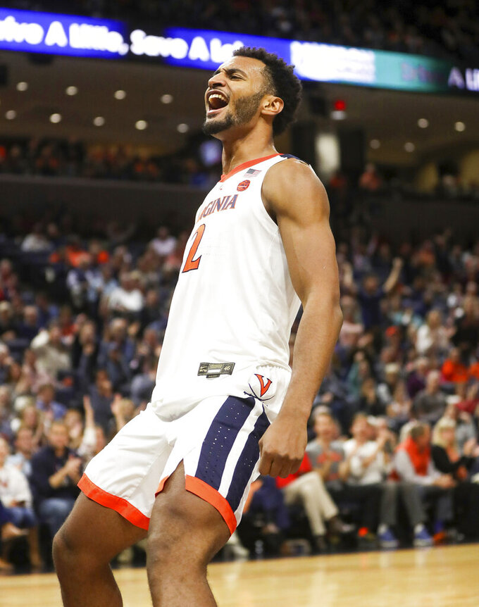 Virginia guard Braxton Key celebrates a dunk during the team's NCAA college basketball game against James Madison in Charlottesville, Va., Sunday, Nov. 10, 2019. Virginia won 65-34. (AP Photo/Andrew Shurtleff)
