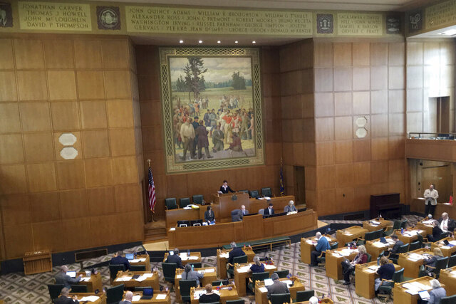 FILE - In this April 26, 2017, file photo, lawmakers in Oregon's House of Representatives sit-in session in Salem, Ore. Acknowledging Oregon's history of racism, Democratic leaders in the House pledged Monday, Jan. 4, 2021, to open paths for more diverse representation in the Legislature and its leadership. In a related development, Rep. Janelle Bynum, who is Black, announced she is dropping her bid to unseat Rep. Tina Kotek, who is white, as House speaker. Back in 2017, Bynum had noted that Oregon's original Constitution prohibited Black people from residing in the territory and said she was reminded of that by the huge mural of white settlers on the House wall. (AP Photo/Andrew Selsky, File)
