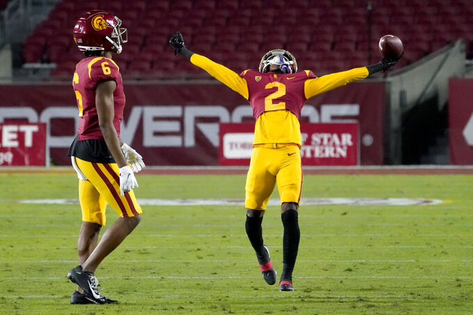 Southern California cornerback Olaijah Griffin, right, celebrates after an interception during the first half of an NCAA college football game against the Washington State in Los Angeles, Sunday, Dec. 6, 2020. (AP Photo/Alex Gallardo)