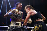 Claressa Shields, left, fights with Ivana Habazin during the third round of a women's 154-pound title boxing bout in Atlantic City, N.J., Friday, Jan. 10, 2020. (AP Photo/Matt Rourke)