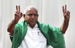 Bharatiya Janata Party (BJP) leader B. S. Yeddyurappa flashes victory sign after he was sworn in as Chief Minister of Karnataka state in Bangalore, India, Thursday, May 17, 2018. The elections in India's southern state of Karnataka were held on last Saturday. (AP Photo/Aijaz Rahi)
