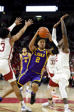 LSU forward Trendon Watford (2) tries to drive past Arkansas defenders Desi Sills (3) and Adrio Bailey (2) during the second half of an NCAA college basketball game Wednesday, March 4, 2020, in Fayetteville, Ark. (AP Photo/Michael Woods)