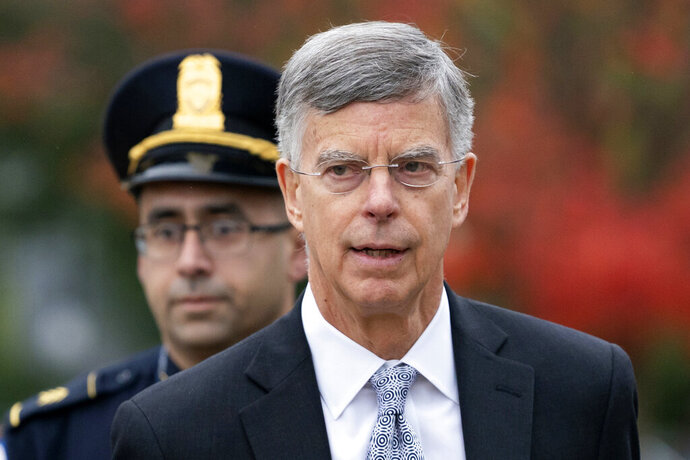 FILE - In this Oct. 22, 2019, file photo, Ambassador William Taylor is escorted by U.S. Capitol Police as he arrives to testify before House committees as part of the Democrats' impeachment investigation of President Donald Trump, at the Capitol in Washington. Taylor, the top U.S. diplomat in Ukraine, told lawmakers last month that President Donald Trump was withholding military aid for Ukraine unless the country's president agreed publicly to investigate Democrats, according to a transcript of his closed-door testimony released by impeachment investigators on Nov. 6. (AP Photo/J. Scott Applewhite, File)
