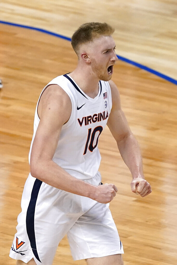 Virginia forward Sam Hauser (10) reacts to a score during the second half of an NCAA college basketball against Syracuse game in the quarterfinal round of the Atlantic Coast Conference tournament in Greensboro, N.C., Thursday, March 11, 2021. (AP Photo/Gerry Broome)
