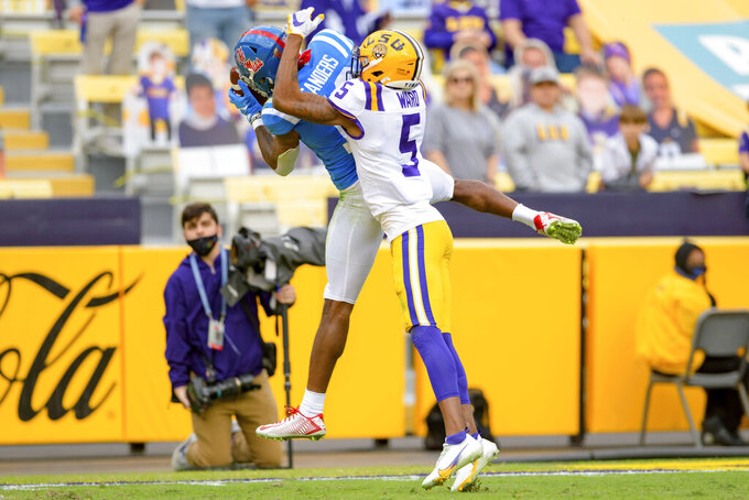 Mississippi wide receiver Braylon Sanders (13) scores a touchdown against LSU cornerback Jay Ward (5) during the first half of an NCAA college football game in Baton Rouge, La., Saturday, Dec. 19, 2020. (AP Photo/Matthew Hinton)