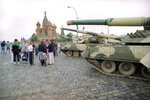 FILE In this Monday, Aug. 19, 1991 file photo, groups of people wander among the half dozen Soviet tanks parked behind the Red Square with St. Basil's Cathedral in the background, near the bank of the Moscow River, Russia. The August 1991 coup that briefly ousted Soviet leader Mikhail Gorbachev collapsed in just three days, precipitating the breakup of the Soviet Union that plotters said they were trying to prevent. (AP Photo/Boris Yurchenko, File)