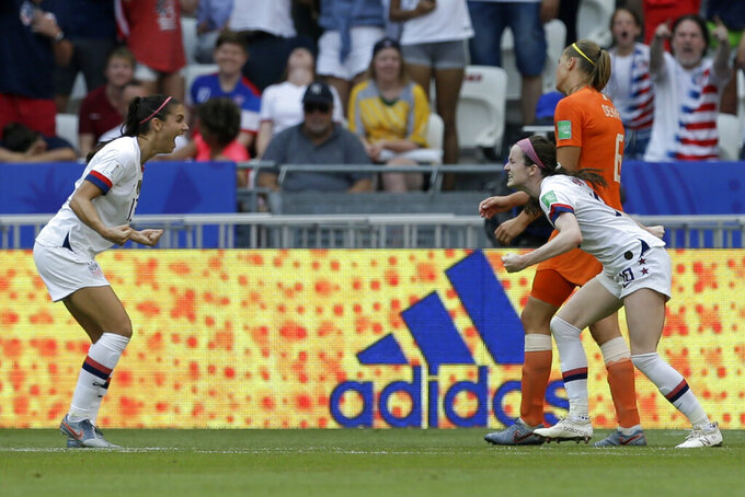 FILE- In this July 7, 2019, file photo, United States' Rose Lavelle, right, celebrates with teammate Alex Morgan after scoring her side's second goal during the Women's World Cup final soccer match against The Netherlands at the Stade de Lyon in Decines, outside Lyon, France. (AP Photo/Claude Paris, FIle)
