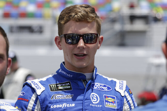 Matt Tifft stands on pit road before a NASCAR auto race at Daytona International Speedway on Tuesday, July 7, 2019, in Daytona Beach, Fla. (AP Photo/Terry Renna)