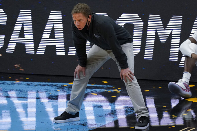 Gonzaga head coach Mark Few watches from the bench during the first half of a men's Final Four NCAA college basketball tournament semifinal game against UCLA, Saturday, April 3, 2021, at Lucas Oil Stadium in Indianapolis. (AP Photo/Darron Cummings)