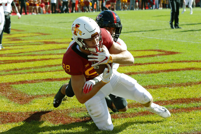 Iowa State tight end Charlie Kolar catches a 9-yard touchdown pass in front of Texas Tech defensive back John Bonney during the first half of an NCAA college football game, Saturday, Oct. 27, 2018, in Ames, Iowa. (AP Photo/Charlie Neibergall)