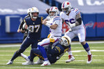 Buffalo Bills quarterback Josh Allen (17) is sacked by Los Angeles Chargers defensive end Isaac Rochell (98) during the first half of an NFL football game, Sunday, Nov. 29, 2020, in Orchard Park, N.Y. (AP Photo/Adrian Kraus)