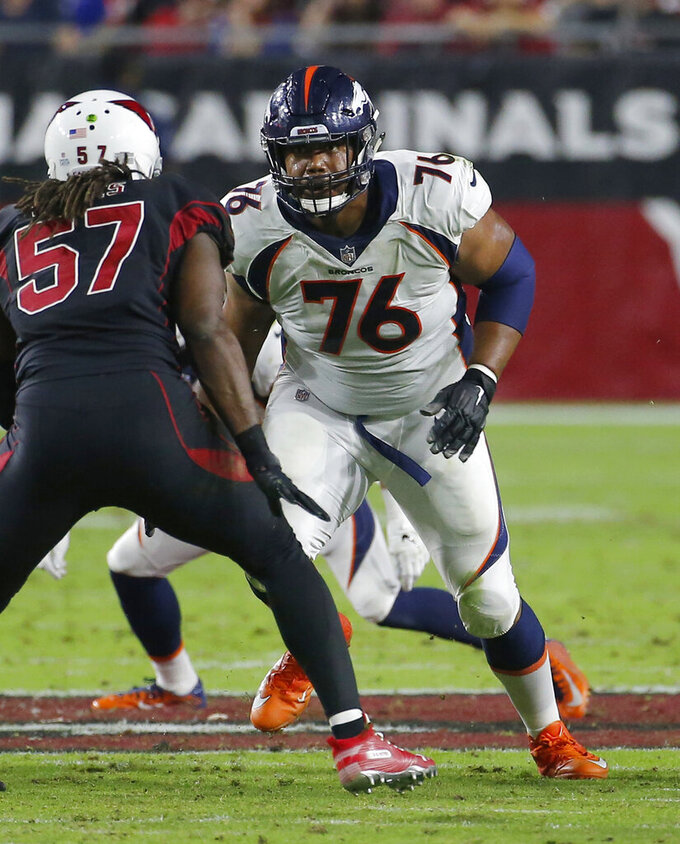 FILE - In this Oct. 18, 2018, file photo, Denver Broncos offensive guard Max Garcia works against the Arizona Cardinals during an NFL football game in Glendale, Ariz.  Garcia and New Orleans Saints receiver Austin Carr are the Super Bowl Gospel Choir's two active players. Garcia says he found out about the choir from a teammate and was put in touch with Johnson. (AP Photo/Rick Scuteri, File