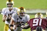 Notre Dame offensive lineman Jarrett Patterson (55) gets ready to block Florida State defensive tackle Robert Cooper (91) in the third quarter of an NCAA college football game Sunday, Sept. 5, 2021, in Tallahassee, Fla. (AP Photo/Phil Sears)