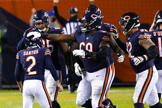 Chicago Bears kicker Cairo Santos (2) is congregated by teammates after the go-ahead field goal against the Tampa Bay Buccaneers during the second half of an NFL football game in Chicago, Thursday, Oct. 8, 2020. The Bears won 20-19. (AP Photo/Charles Rex Arbogast)