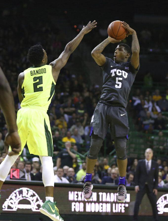 TCU guard Kendric Davis, right, scores over Baylor guard Devonte Bandoo, left, in the first half of an NCAA college basketball game, Saturday, Feb. 2, 2019, in Waco, Texas. (Rod Aydelotte/Waco Tribune Herald, via AP)