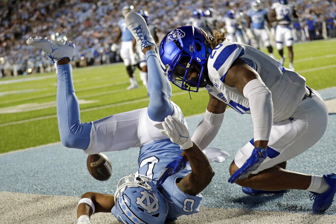 North Carolina wide receiver Emery Simmons (0)can't make the catch as he is defended by Georgia State cornerback Quavian White (20) during the first half of an NCAA college football game in Chapel Hill, N.C., Saturday, Sept. 11, 2021. (AP Photo/Chris Seward)