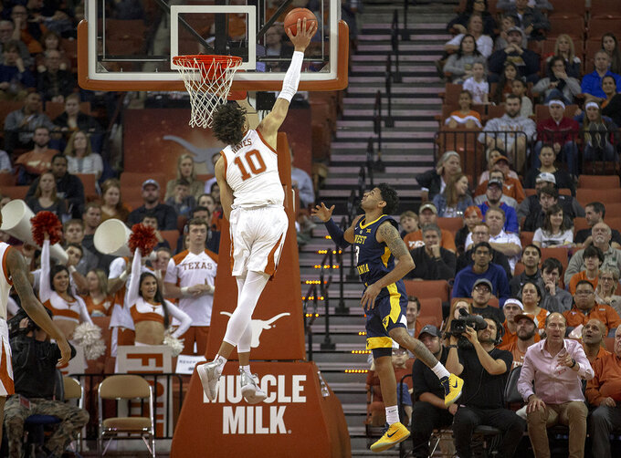 Texas forward Jaxson Hayes (10) blocks a shot by West Virginia guard James Bolden (3) during an NCAA college basketball game on Saturday, Jan. 5, 2019, in Austin, Texas. (Nick Wagner/Austin American-Statesman via AP)