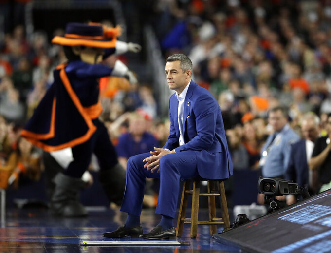 Virginia head coach Tony Bennett watches his team during the first half in the semifinals of the Final Four NCAA college basketball tournament against Auburn, Saturday, April 6, 2019, in Minneapolis. (AP Photo/Jeff Roberson)