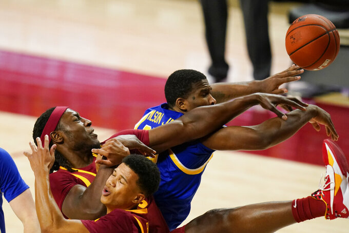 Iowa State forward Solomon Young, left, and guard Rasir Bolton, center, fight for a rebound with South Dakota State forward Douglas Wilson, right, during the second half of an NCAA college basketball game, Wednesday, Dec. 2, 2020, in Ames, Iowa. (AP Photo/Charlie Neibergall)