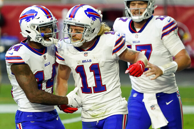 Buffalo Bills wide receiver Cole Beasley (11) celebrates his touchdown with wide receiver Stefon Diggs (14) during the second half of an NFL football game against the Arizona Cardinals, Sunday, Nov. 15, 2020, in Glendale, Ariz. (AP Photo/Rick Scuteri)