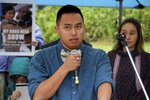Esau Sinnok of Shishmaref, Alaska, speaks at a news conference after the Alaska Supreme Court heard arguments Wednesday, Oct. 9, 2019, in Anchorage, Alaska, in a lawsuit that claims state policy on fossil fuels is harming the constitutional right of young Alaskans to a safe climate. Sinnok and 15 other Alaska youths in 2017 sued the state, claiming that human-caused greenhouse gas emission leading to climate change is creating long-term, dangerous health effects. They lost in Superior Court, but appealed to Alaska's highest court. (AP Photo/Mark Thiessen)