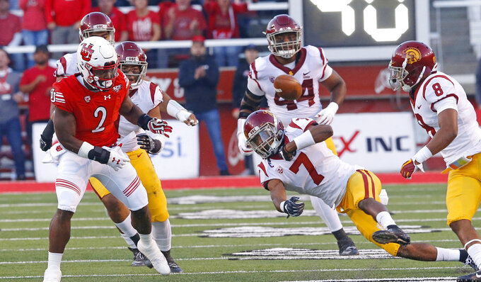 Southern California safety Marvell Tell III (7) reaches for a fumble from Utah running back Zack Moss (2) during the first half of an NCAA college football game Saturday, Oct. 20, 2018, in Salt Lake City. (AP Photo/Rick Bowmer)