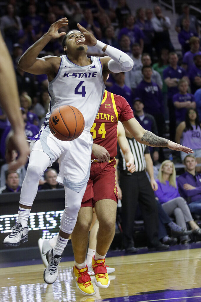 Kansas State guard David Sloan (4) is stripped of the ball by Iowa State guard Nate Jenkins (34) during the second half of an NCAA college basketball game in Manhattan, Kan., Saturday, March 7, 2020. (AP Photo/Orlin Wagner)