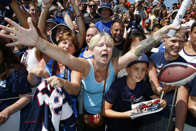 FILE - In this July 30, 2016, file photo, fans react to New England Patriots quarterback Tom Brady during an autograph session following an NFL football training camp practice in Foxborough, Mass. Tom Brady is an NFL free agent for the first time in his career. The 42-year-old quarterback with six Super Bowl rings said Tuesday morning, March 17, 2020, that he is leaving the New England Patriots. (AP Photo/Michael Dwyer, File)