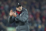 Liverpool's manager Jurgen Klopp applauds at the end of the English Premier League soccer match between Liverpool and Wolverhampton Wanderers at Anfield Stadium, Liverpool, England, Sunday Dec. 29, 2019. Liverpool won 1-0. (AP Photo/Jon Super)