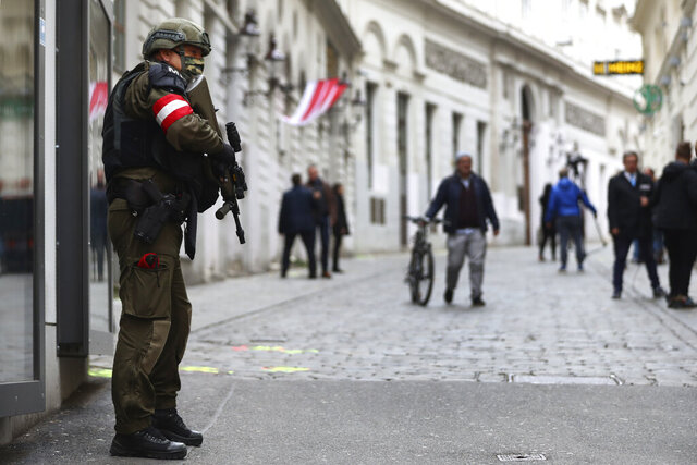 A military police officer guard at the crime scene near a synagogue in Vienna, Austria, Wednesday, Nov. 4, 2020. Several shots were fired shortly after 8 p.m. local time on Monday, Nov. 2, in a lively street in the city center of Vienna. (AP Photo/Matthias Schrader)