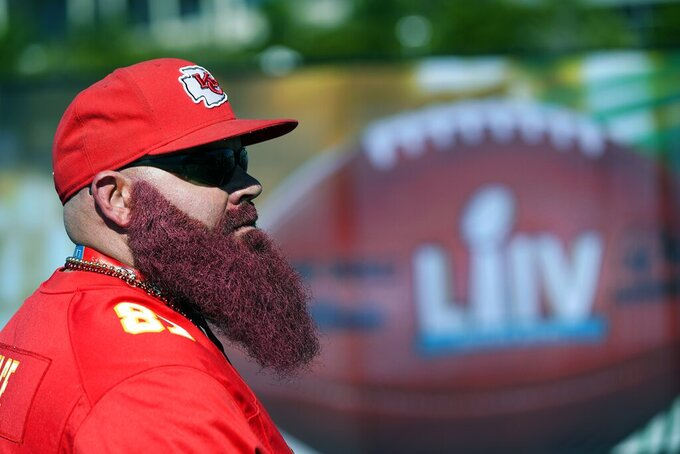 A Kansas City Chiefs fan arrives for the NFL Super Bowl 54 football game between the Chiefs and the San Francisco 49ers Sunday, Feb. 2, 2020, in Miami. (AP Photo/David J. Phillip)